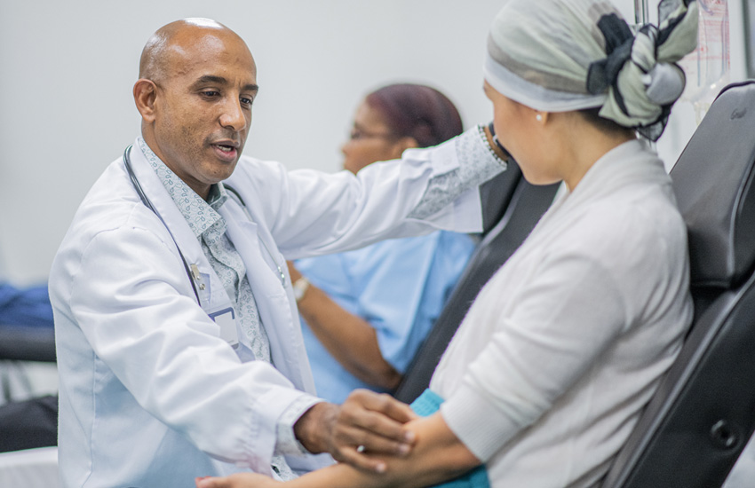 Dr speaking with oncology patient