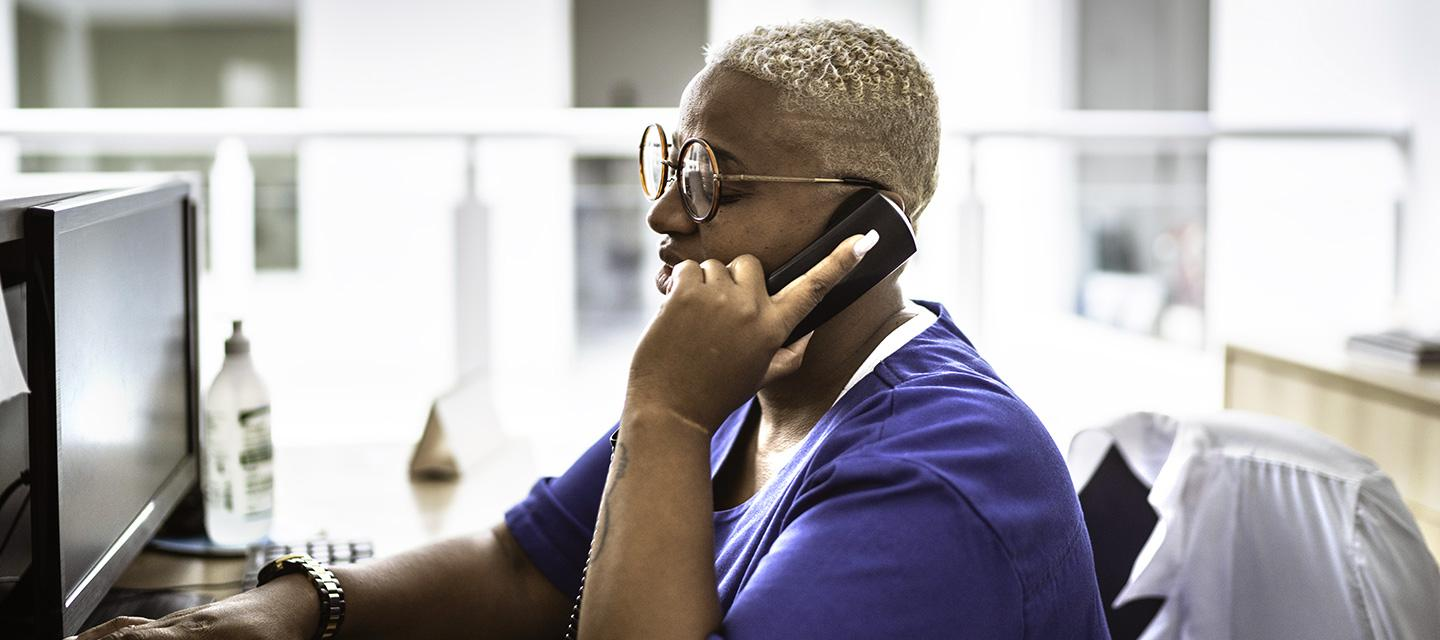 african-american female nurse on the phone at her desk