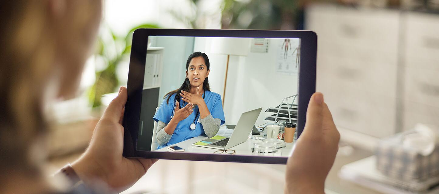 patient talking to physician or nurse on a tablet device